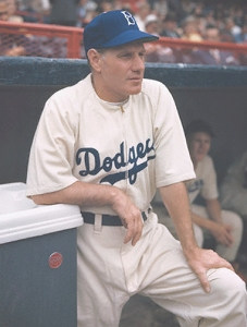 July 1946 --- Manager Leo Durocher, of the Brooklyn Dodgers, is shown at the edge of the dugout during a game. --- Image by © Bettmann/CORBIS